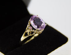 13 ct natural pink kunzite ring with diamonds and sapphires. No reserve