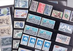 TAAF 1957/1992 - Composition of stamps and series mounted on black plastic sheets