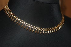 A solid 18 kt / 750 gold necklace