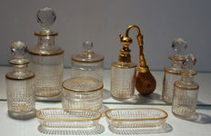 An extensive Baccarat crystal nine piece dressing table set, France, second half 20th century