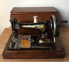 Antique Singer sewing machine in wooden case, year 1896