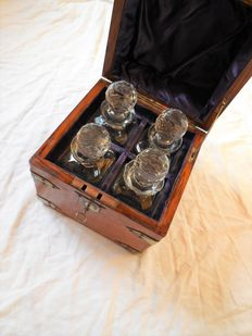 Old travel set made of exotic wood with metal fittings with 4 carafes/liquor bottles