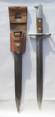 Swiss long model 1918 early bayonet, complete with sheath and holder in excellent condition.