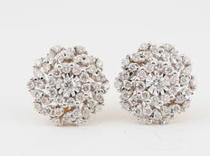 14kt diamond earrings total 0.78ct. Measurements: 14.8 x 12.5 x12.00 mm.