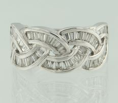 18 kt white gold fantasy ring set with taper cut diamonds