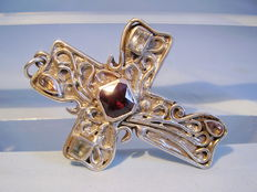 Large cross-shaped pendant with gemstones