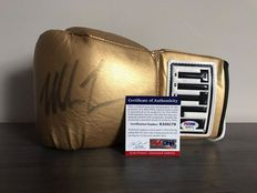 PSA-approved, signed, title boxing glove from Mike Tyson with a general picture of the signing session.