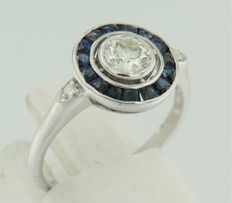 14 kt white gold ring set with sapphire and brilliant cut diamonds
