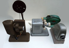 Four antique hand-held projectors, first half of the 20th century, Poland, Netherlands and Germany