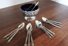 14-pieced silver plated table set in antique style