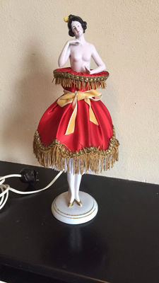 A vintage porcelain lamp of a lady, mid 20th century