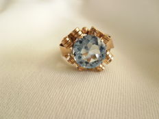 Red gold ring with aquamarine.