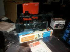 Sony film camera FDR AX1 4k with microphone, tripod, spotlight and accessories