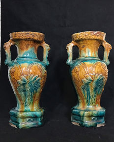Porcelain baluster vase with enamelled yellow and blue floral decorations, and stylised handles – China – 19th century.