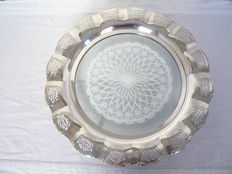 Round silver plated serving tray with open worked edge and glass in the middle, first half 20th century