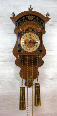 Salland beechwood wall clock 'Thomas Tompion London' - richly decorated with moonphases - second half 20th century.
