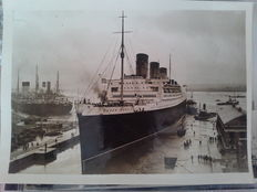 10 vintage press photos of the RMS Queen Mary