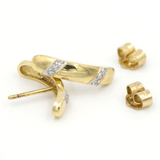 Earrings in 18 kt yellow gold with diamonds weighing 0.06 ct
