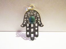 Silver pendant in the shape of the Hand of Fatima with a malachite