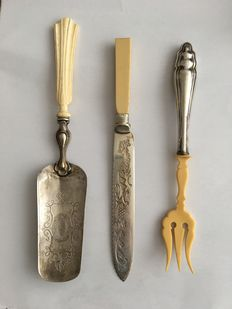 Antique cutlery set with silver handle and cuff and silver cake server with ivory handle, Europe, 1st half of 19th century