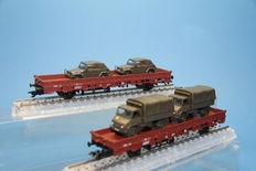 Märklin H0 - 46957/46958 - 2 pieces 4MFOR low car with Volkswagens and loaded with Unimoggs of the DB