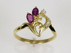 14 kt gold Ring. Rubies. Diamonds 0.07 ct Cut: 57 (18 mm in diameter).