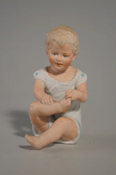 "Porcelain figure ""Seating child"""