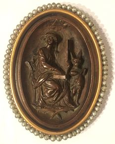 Metal alloy oval bas relief, depicting St Cecilia - between 19th and 20th C
