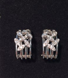 White gold creole style earrings set with diamonds.