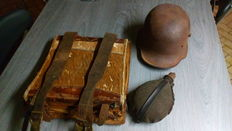German backpack, German field bottle and German steel helmet. All period 1914/1918