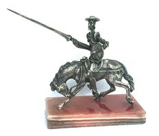 "Sculpture in silver 800/1000 ""Don Quixote"", with base in Onyx, 20th century"