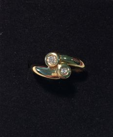 Gold cocktail ring set with diamonds.