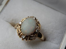 Yellow gold design ring set with 4 brilliant cut diamonds TW VSI-En Opal