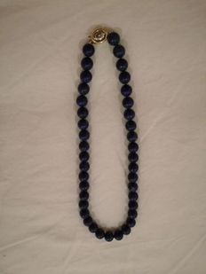 Lapis lazuli necklace with 14 kt gold clasp and diamond.