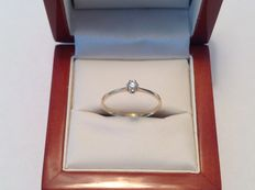 14K yellow gold solitaire ring with a brilliant of 0.10 ct. F-G VVS