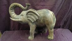 Baby elephant mascot in wood-India, Asia-late 1800s.