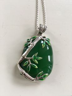 Silver bamboo leaves with enamel decorated special large green jadeite jade pendant on a silver necklace with spheres.