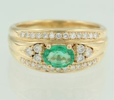 18 kt yellow gold ring centrally set with an oval cut emerald and 35 brilliant cut diamonds
