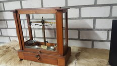 Pharmacists scales with weights in cabinet - ca. 1910