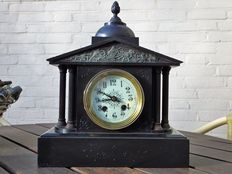 A black marble clock with columns - 1920