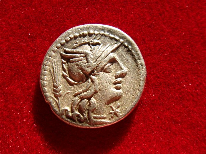 Roman Republic - Cn. Domitius Ahenobarbus silver denarius (3,70 g. 18 mm.). Rome mint, 128 B.C. Victory in biga, man spearing lion below.