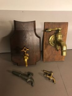Three bronze faucets & a pewter faucet