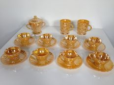 Eight vintage Anchor Hocking Peach Luster tea cups and soucers, two coffee mugs, one sugar pot - 1960 - USA