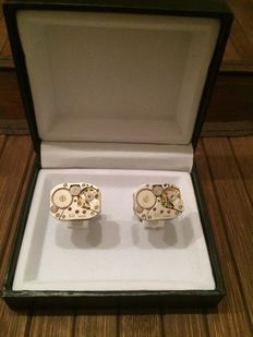 Cufflinks with watch movement - nearly new and never used.