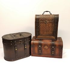 Three colonial wooden cases  with leather and iron details