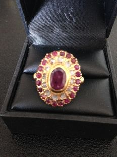 Ring with untreated rubies and diamonds.