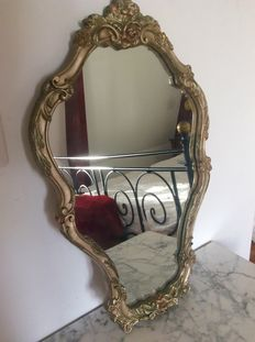 Mirror with ornament from Italy