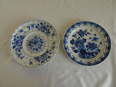 Porceleyne Fles - two wall plates with floral decor, of which one is a pleated one