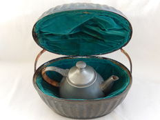 Pewter teapot with tea-cosy