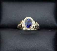 1.82 ct IGI certified blue sapphire and 0.40 diamond ring